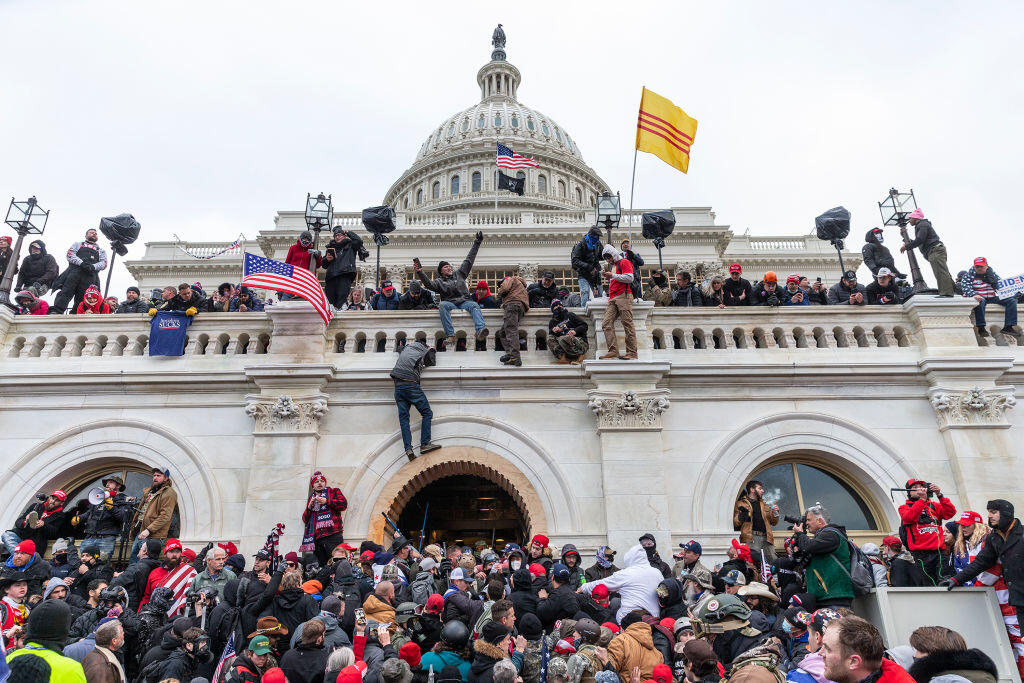 A mob swarms the US Capitol on Jan. 6