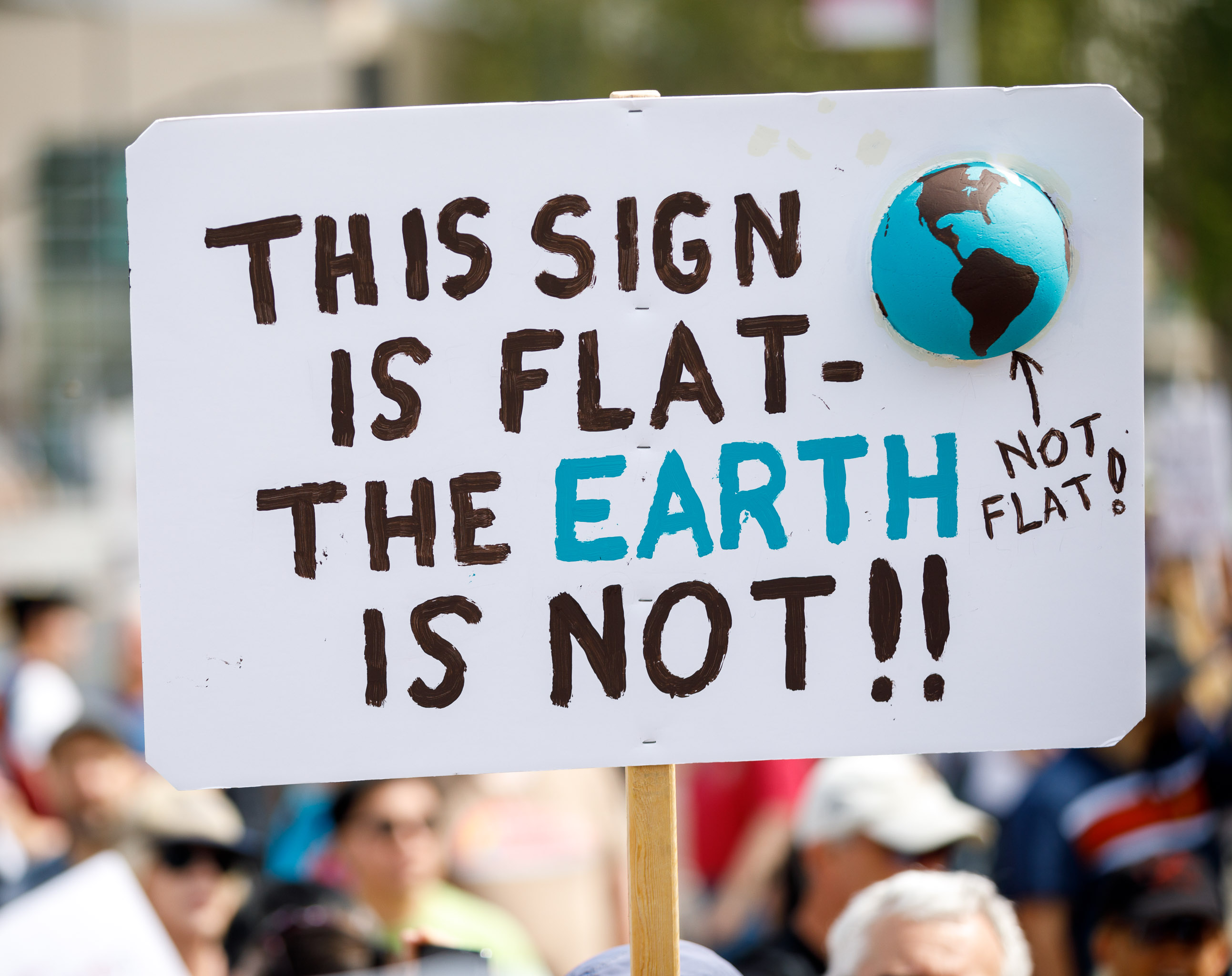 """""""This sign is flat -- the Earth is not!"""" said one sign at the Silicon Valley March for Science, urging people not to regress to an obsolete worldview science helped overturn."""