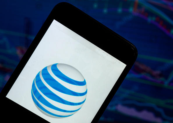 The AT&T logo seen displayed on a smart phone with a