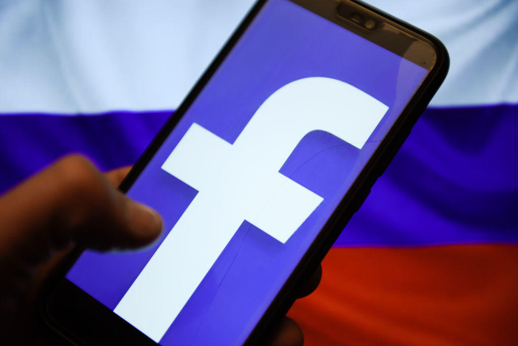 Facebook logo and Russia flag are seen on an android mobile