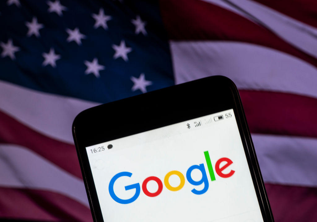 The Google logo seen displayed on a smart phone with a