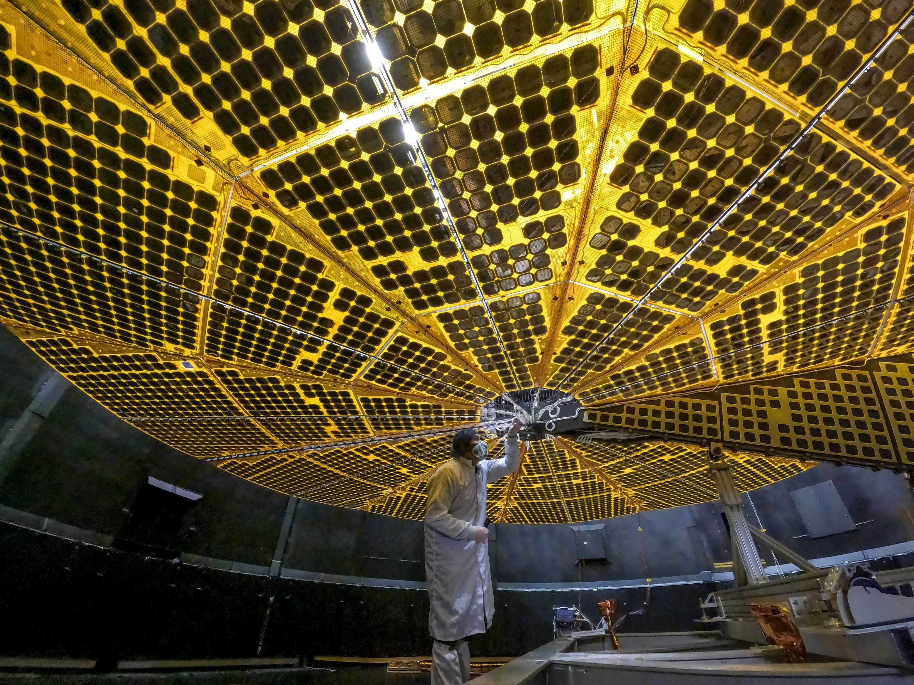 <p>A researcher working on Lucy's solar panels.</p>