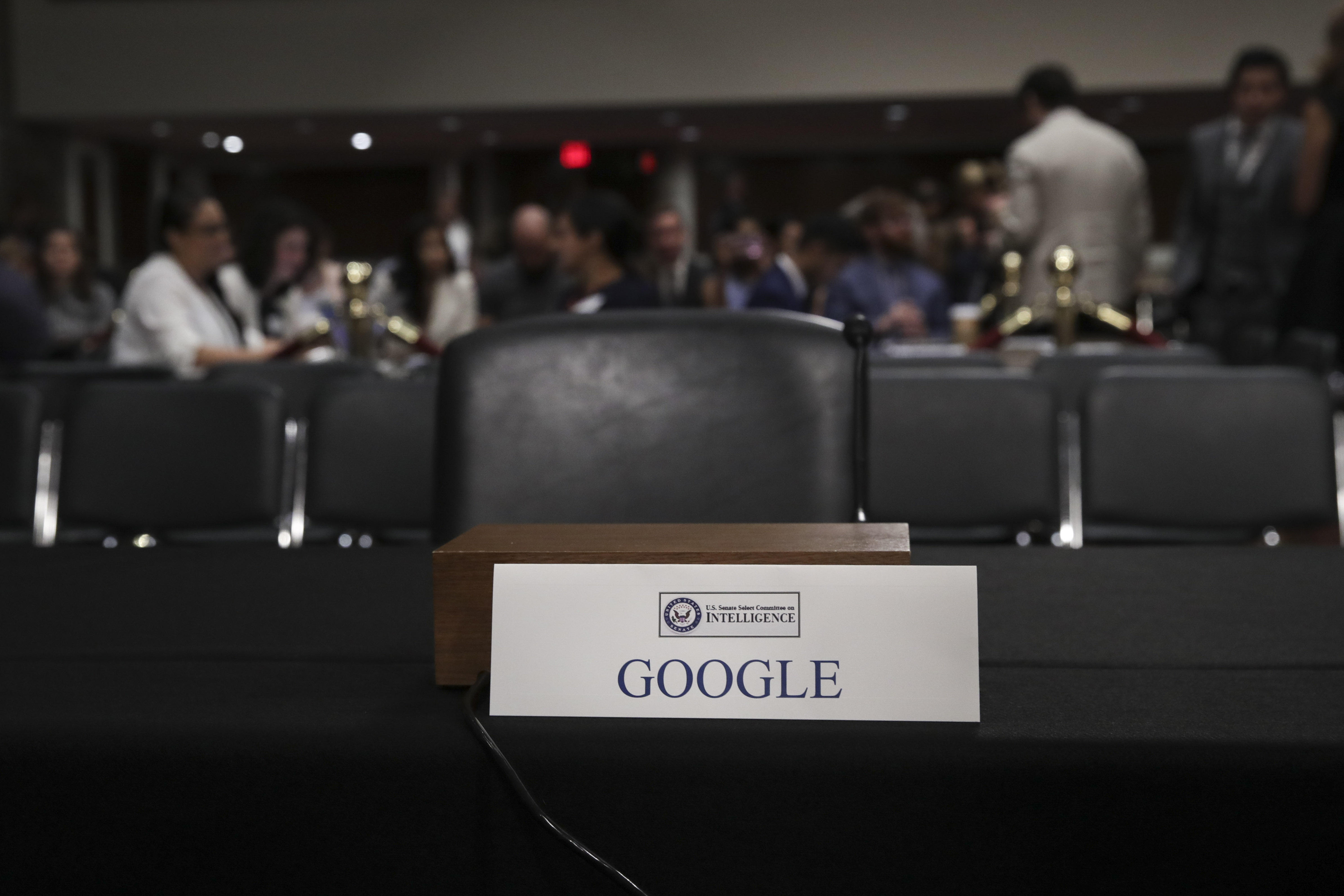An empty seat for Google is seen during a Senate intelligence committee hearing concerning foreign influence operations' use of social media platforms.
