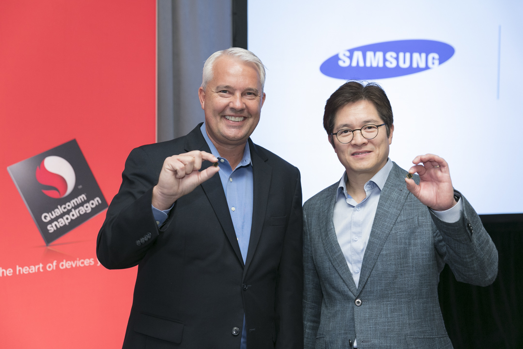 Keith Kressin, left, senior vice president of product management for Qualcomm, and Ben Suh, senior vice president of foundry marketing for Samsung, show off the Snapdragon 835.