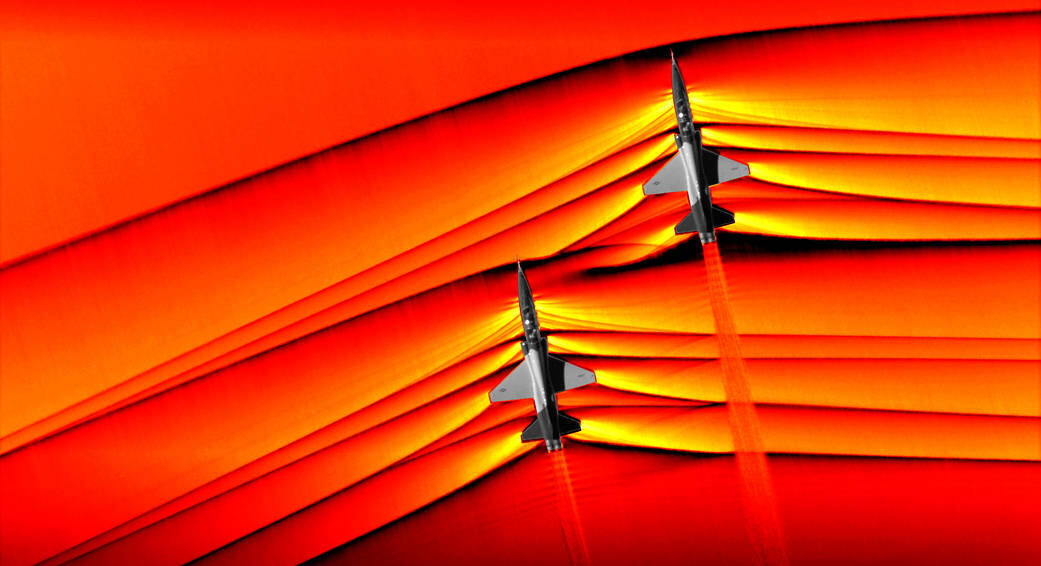 Schlieren imagery showing the shockwaves coming off two T-38 fighter jets midflight.