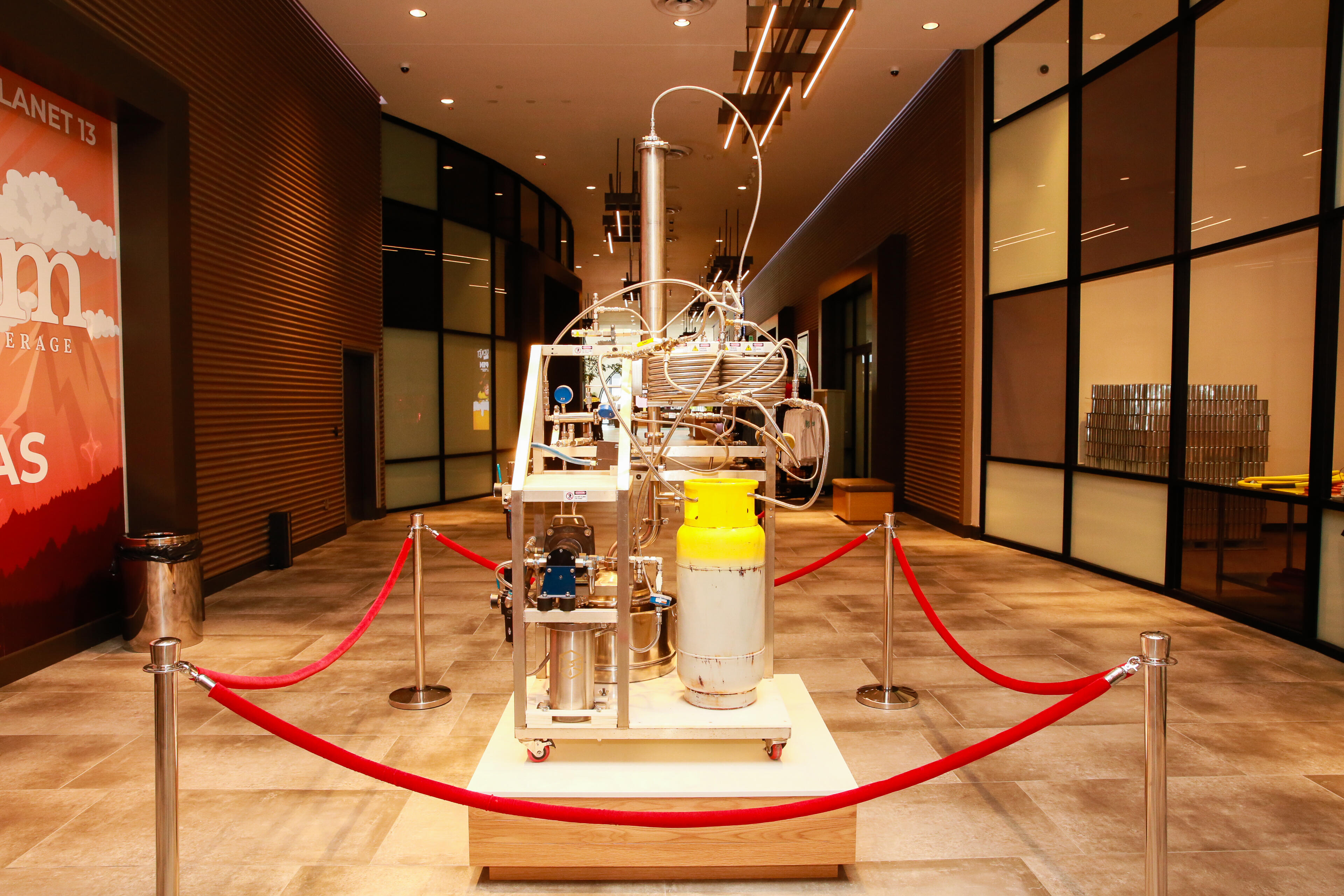"""This """"Turpinator"""" is on display further down the hallway. It's the first equipment used by Planet 13 to pull oils out of cannabis for the dispensary's vape oils and edible products."""