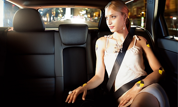 The ubiquitous three-point seat belt connects to the vehicle at the hips and over a single shoulder.