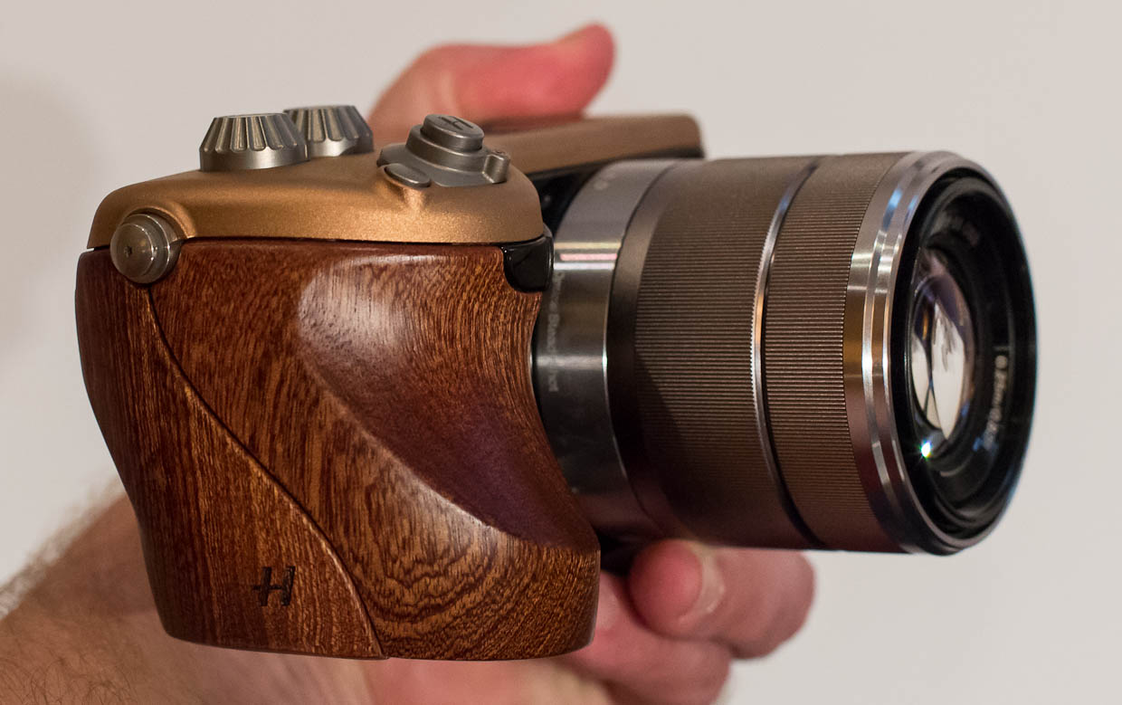 This Hasselblad Lunar prototype brings a sculpted wooden grip and jewel-bedecked controls to a Sony NEX-7 camera design.