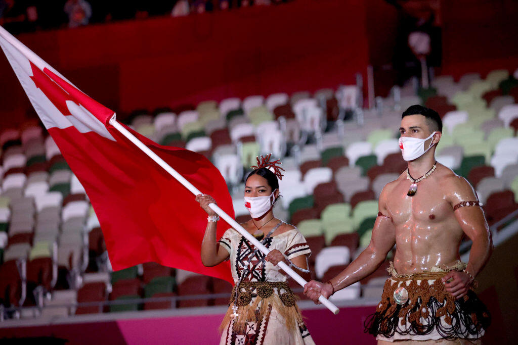 Malia Paseka and Pita Taufatofua of Team Tonga lead their team during the Opening Ceremony of the Tokyo 2020 Olympic Games.