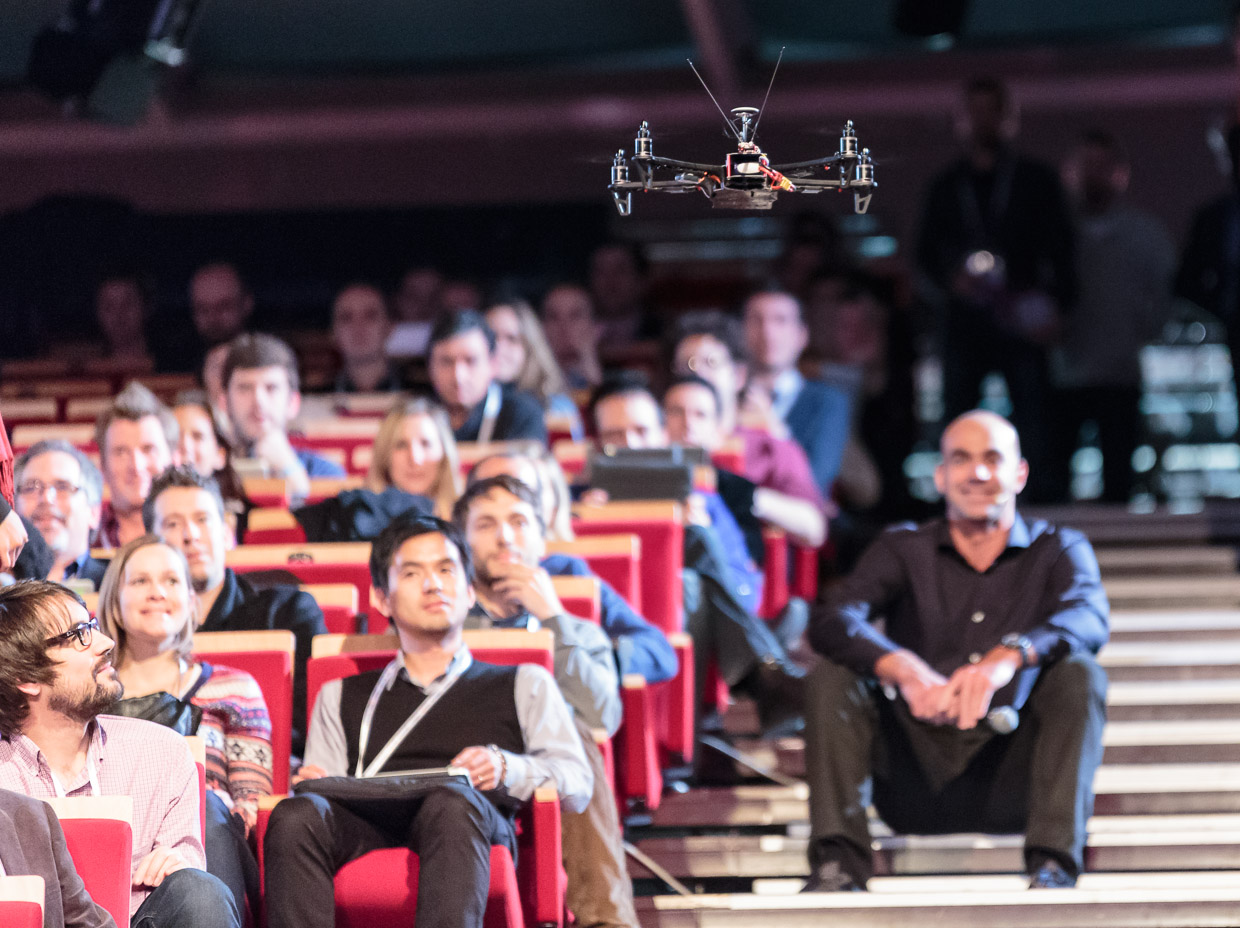 Team BlackSheep's TBS Discovery quadcopter flies above the audience at LeWeb 2012 in Paris.