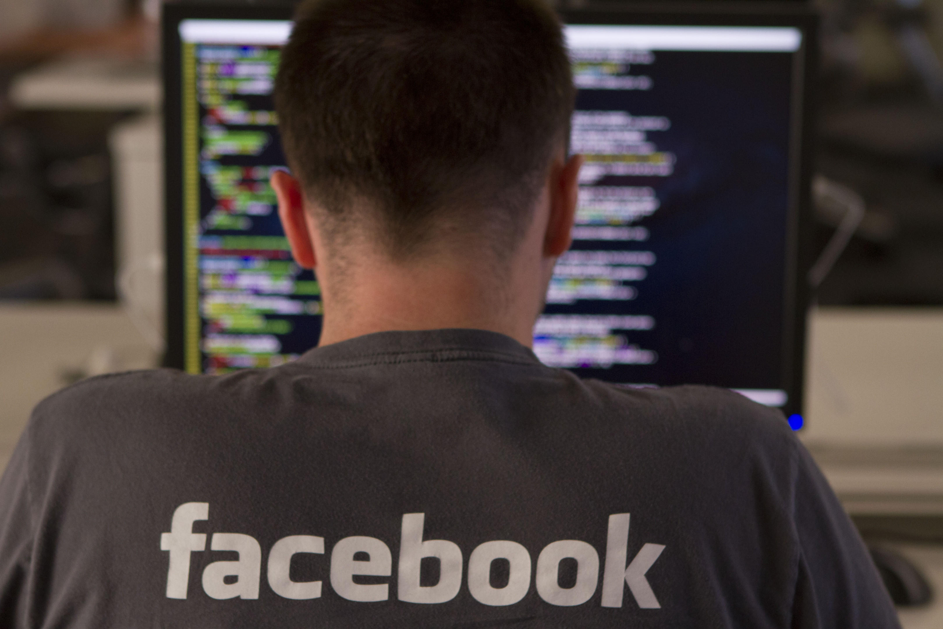 A new employee sits at a computer during Facebook's engineering bootcamp
