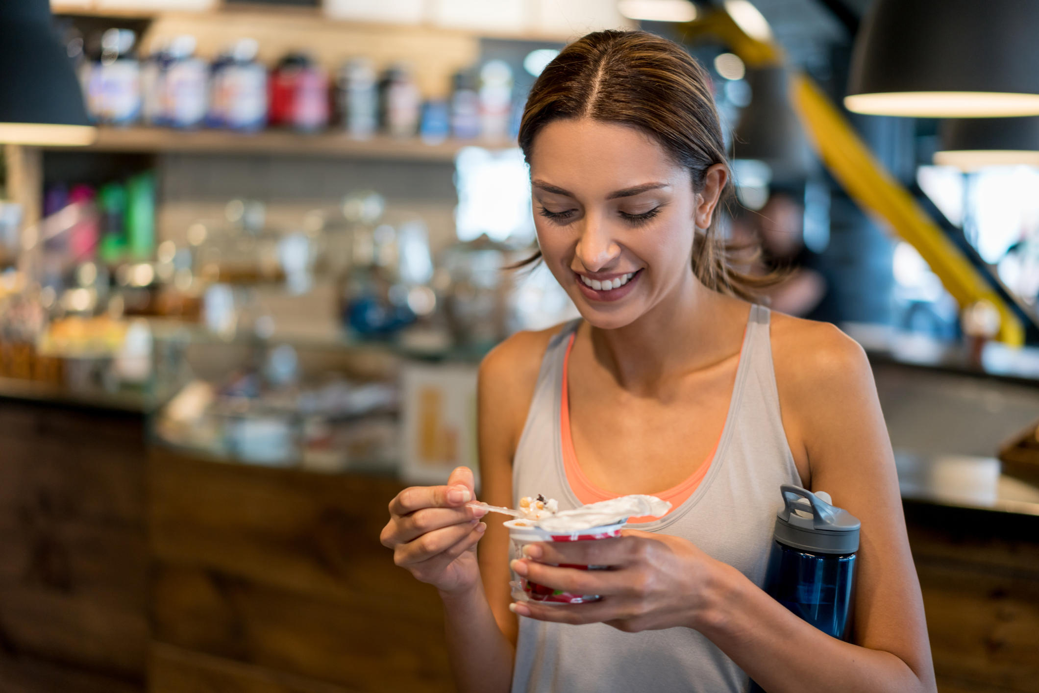 Woman eating a healthy snack at the gym