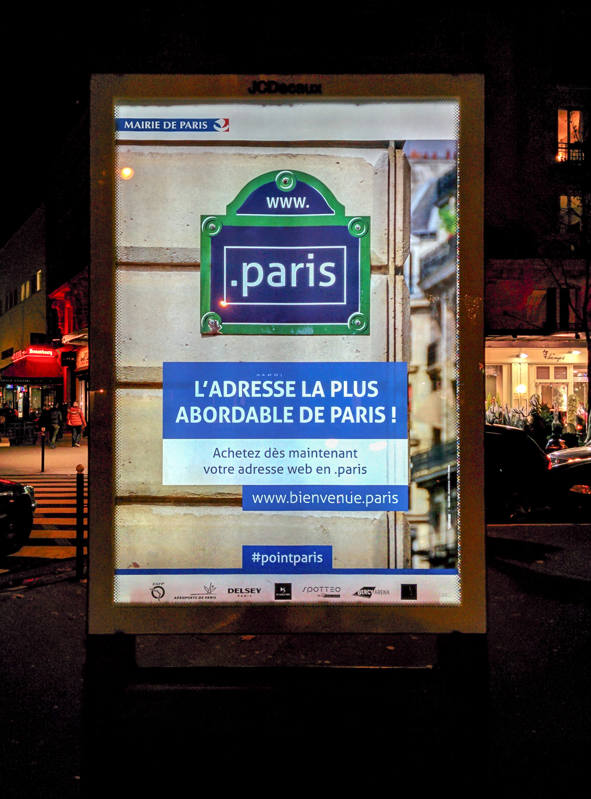 In France, an ad exhorts people to register Internet addresses ending in the new .paris domain name.