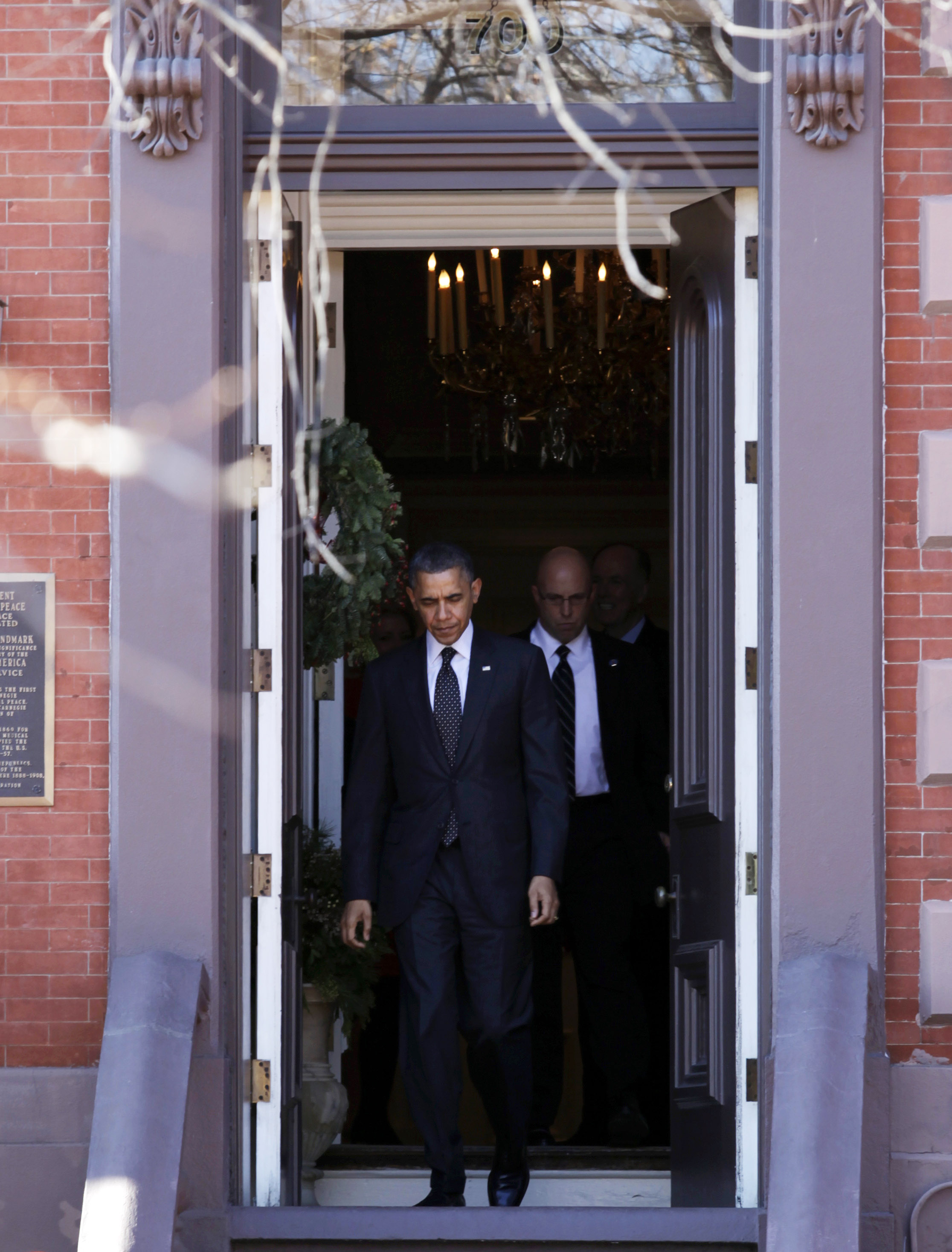 President Barack Obama leaving a National Security Agency Christmas party held across the street from the White House at the Blair House last December.