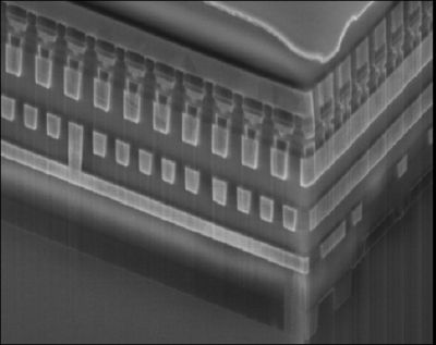 This image shows phase change memory built atop a conventional CMOS microchip. Memory cells can be controlled using rows and columns of wires that lead through the chip.