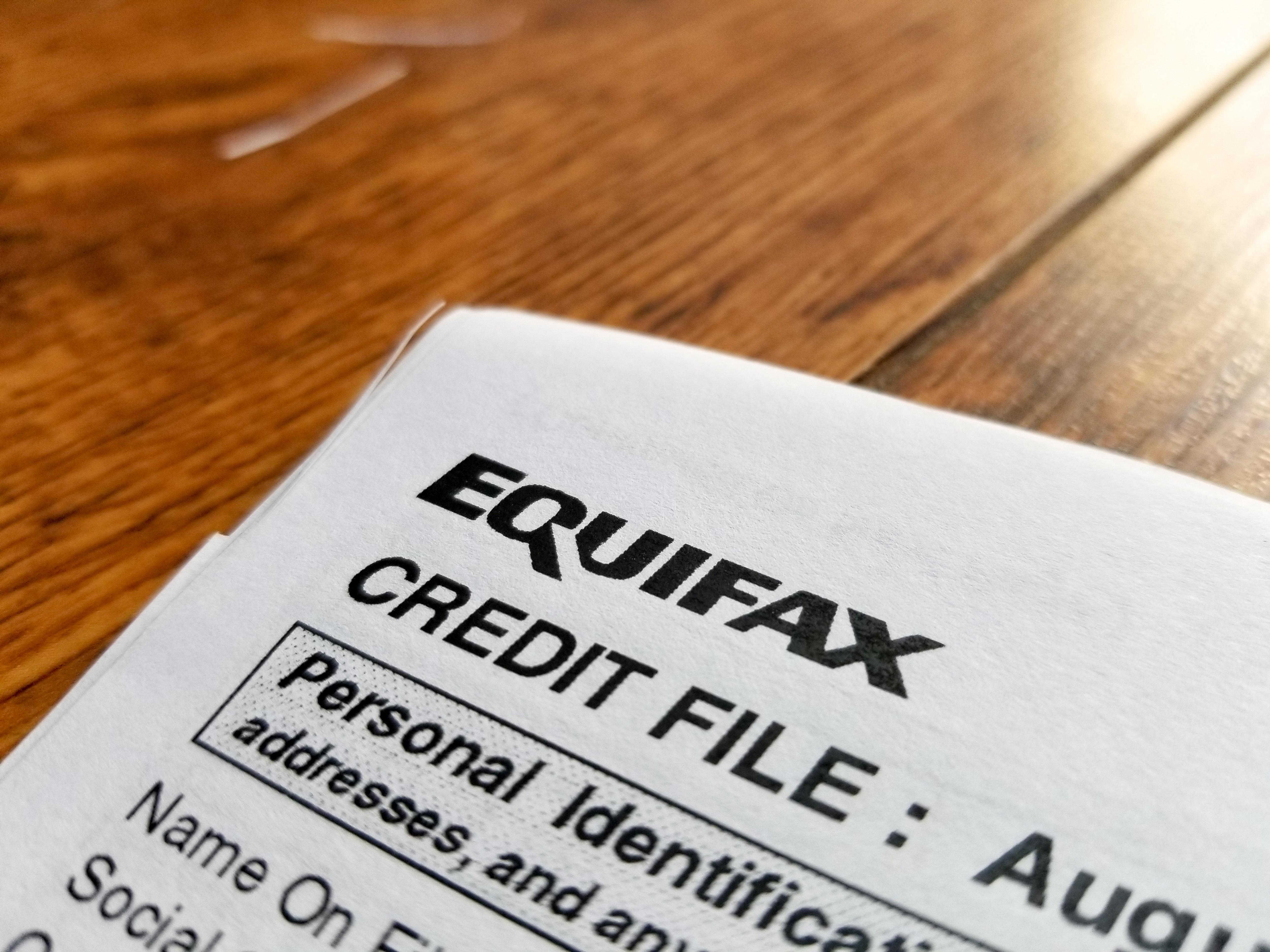 Close-up of the upper corner of a consumer credit report from the credit bureau Equifax, with text reading Credit File and Personal Identification. Equifax executives in charge of information and security have resigned, the company announced Friday, one week after it announced a massive theft of consumer information from its systems.
