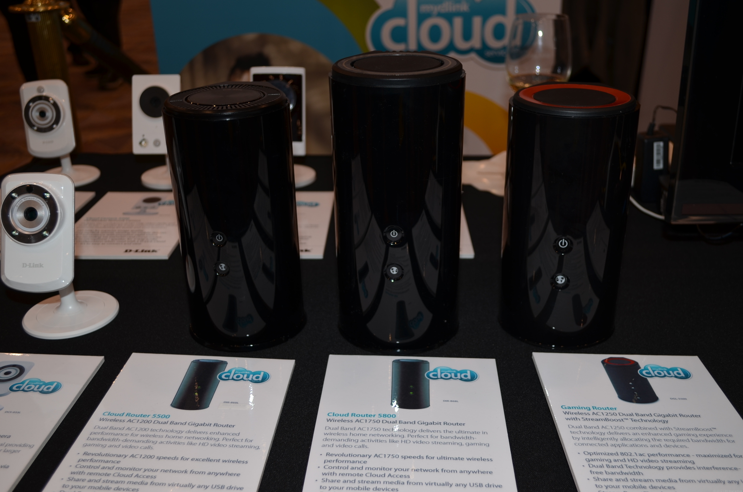 The two new 802.11ac routers, DIR-860L (left) and DIR-868L (middle), next to the all new DGL-5500 (red top) at CES 2013.