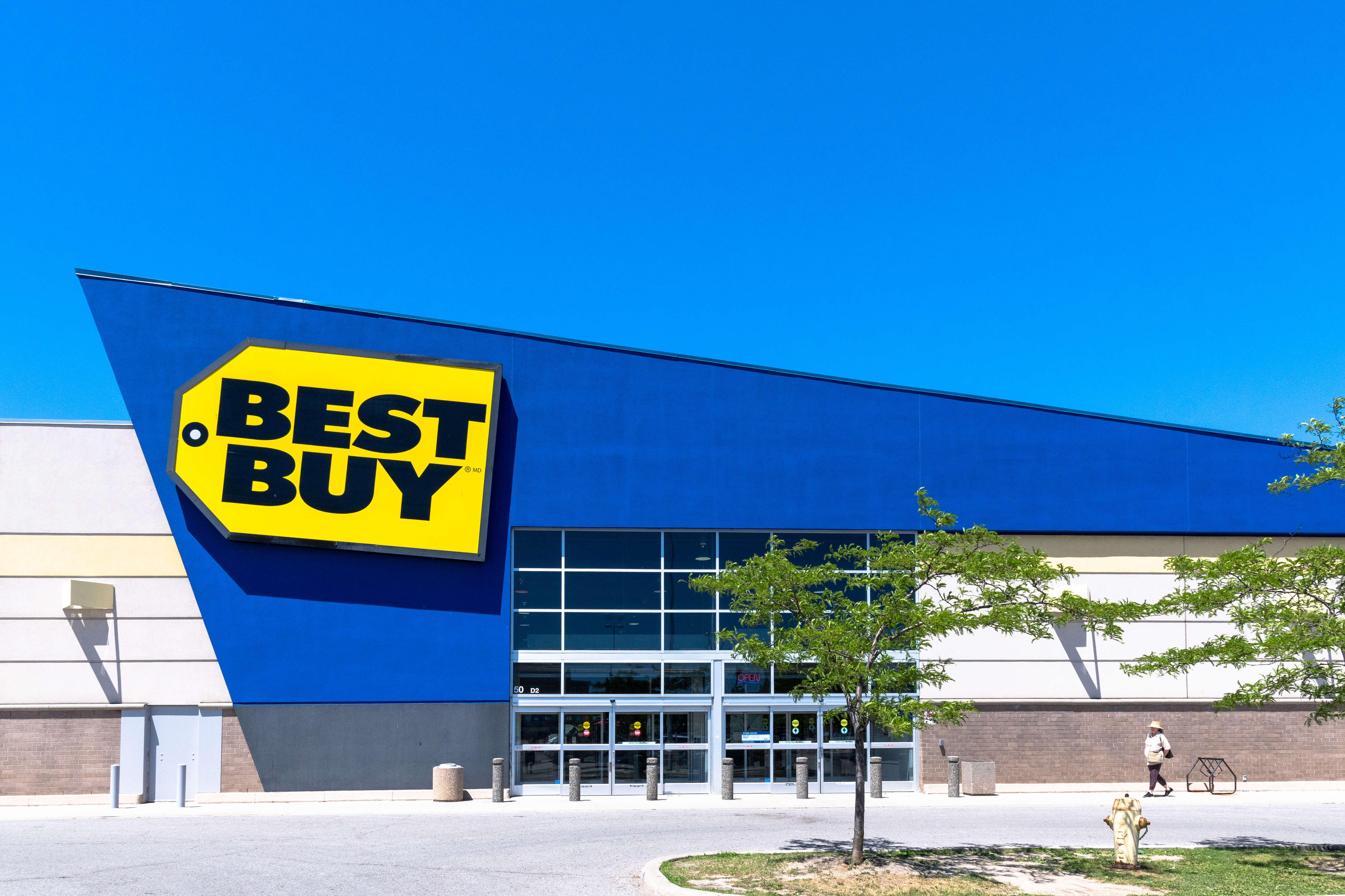 Entrance of a Best Buy deal during a day with blue clarity