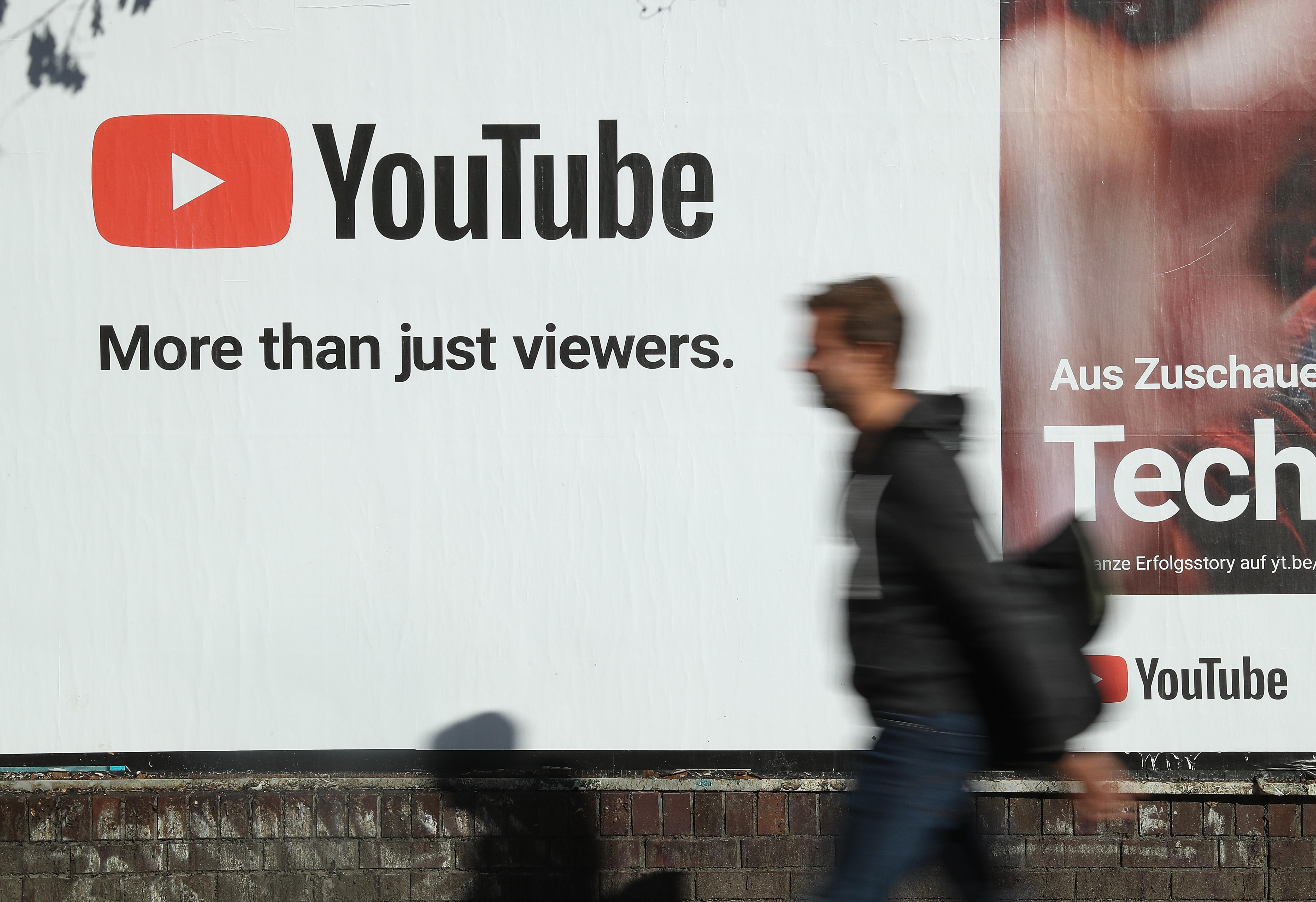 """A YouTube billboard bears the tagline """"More than just viewers."""""""