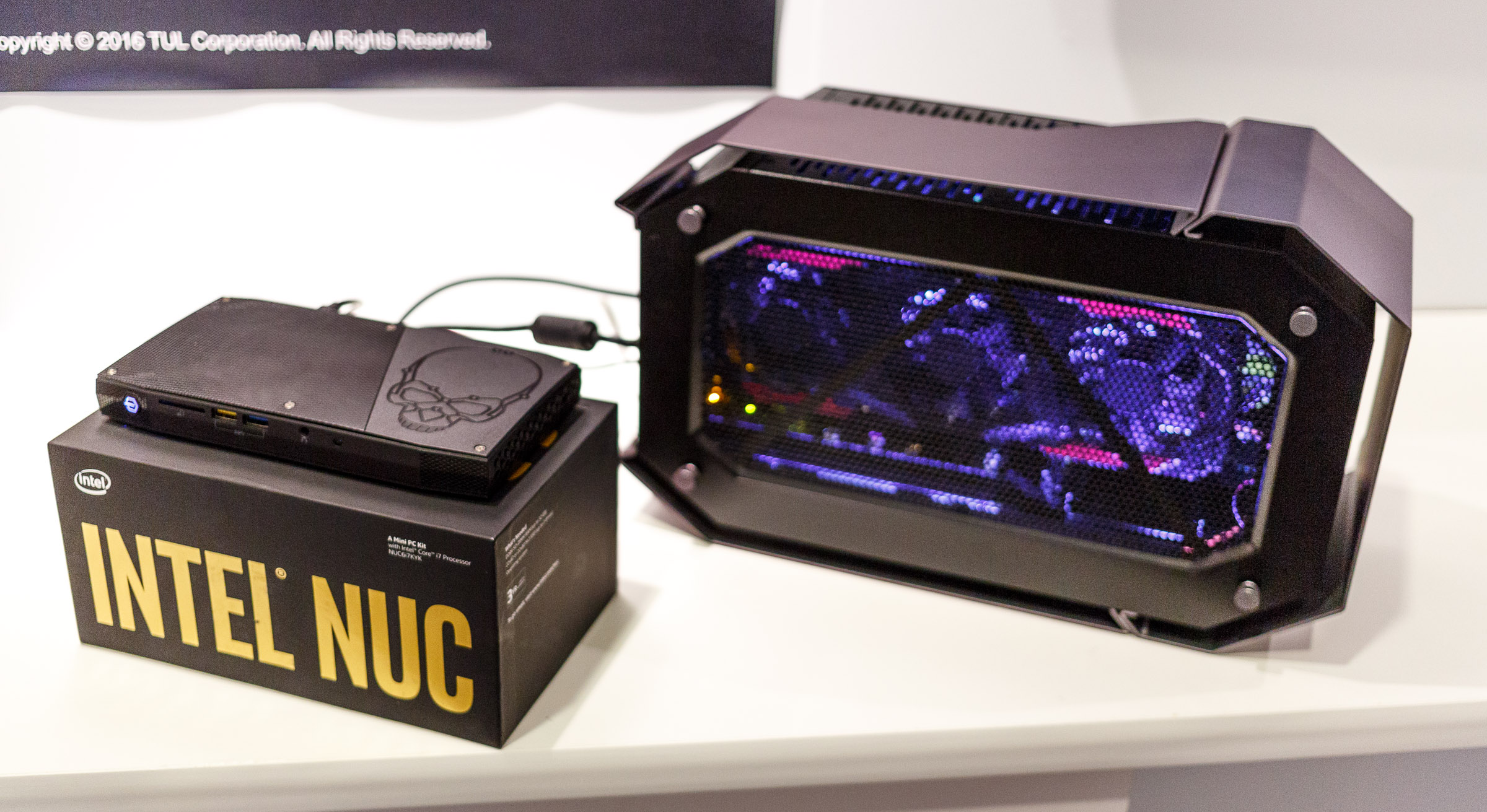 A tiny Intel NUC PC can play high-end games by connecting a hulking desktop graphics card in a Tul Devil Box via a Thunderbolt port.