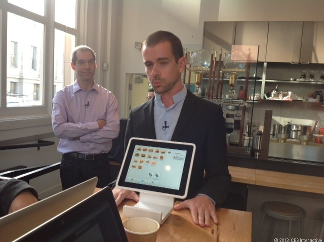 Square CEO Jack Dorsey shows off a Square product.