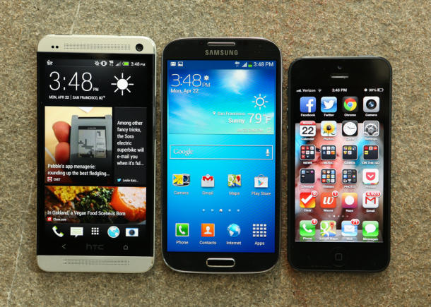 HTC's One, left, alongside the Galaxy S4 and iPhone 5.