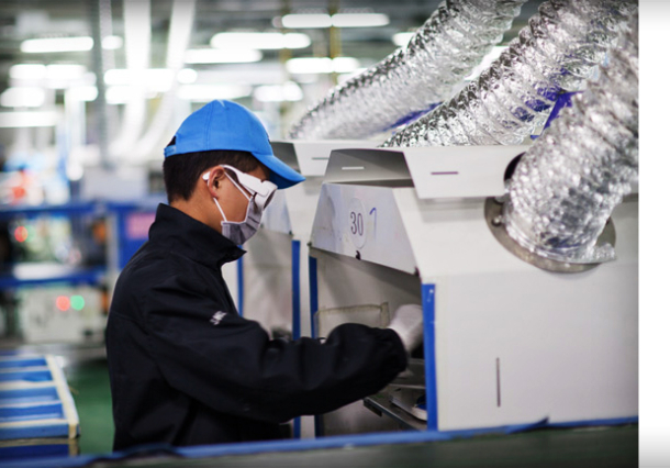 A worker at one of Foxconn's facilities in China, released in January 2012 by Apple as part of its annual Supplier Responsibility report.