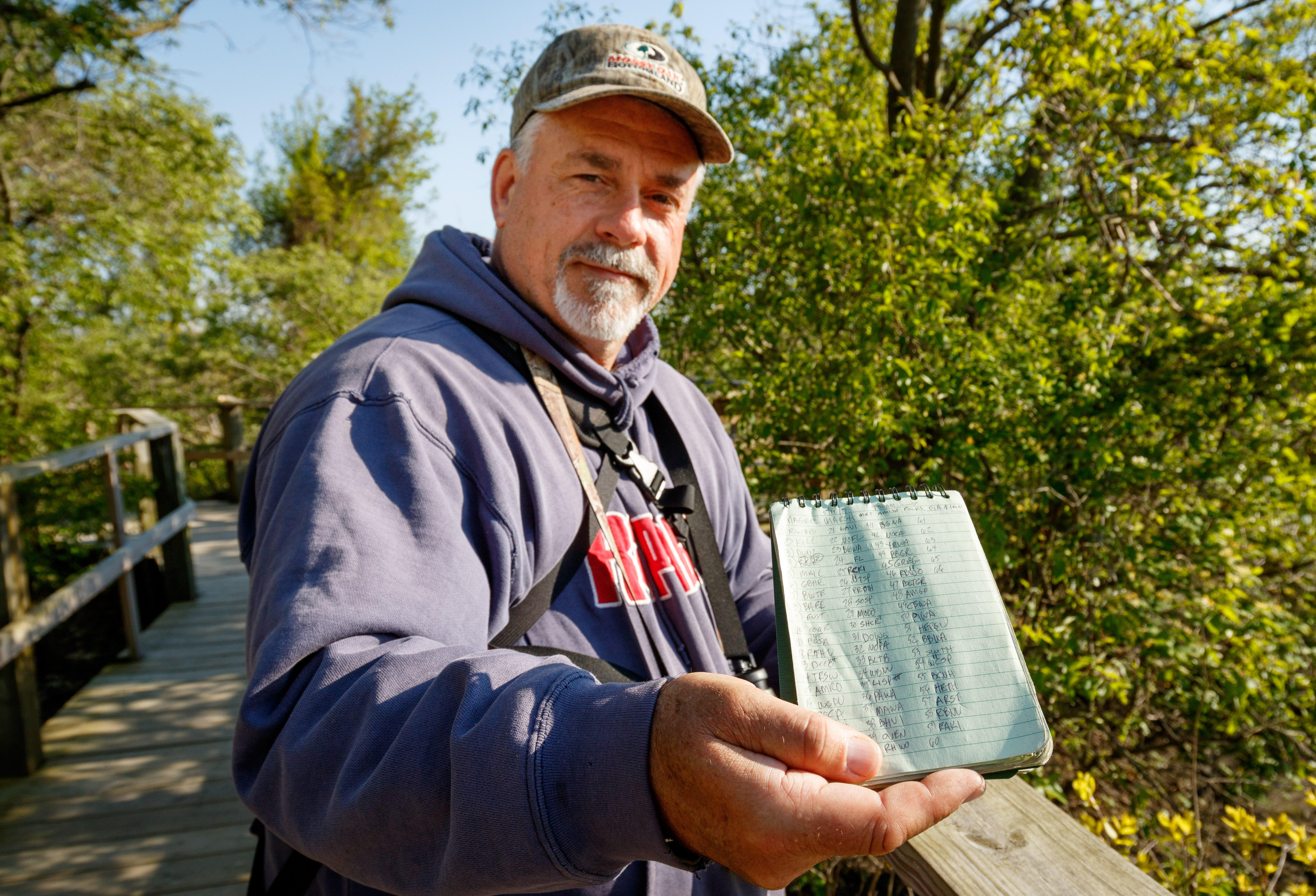 Connecticut birder Tim Thompson keeps track of birds in a notebook, but then logs the species on the eBird service so other birders can benefit from his sightings.