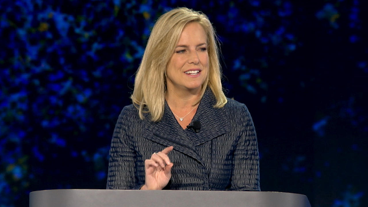 DHS Secretary Kirstjen Nielsen speaks on stage from behind a podium at the RSA Conference in San Francisco.