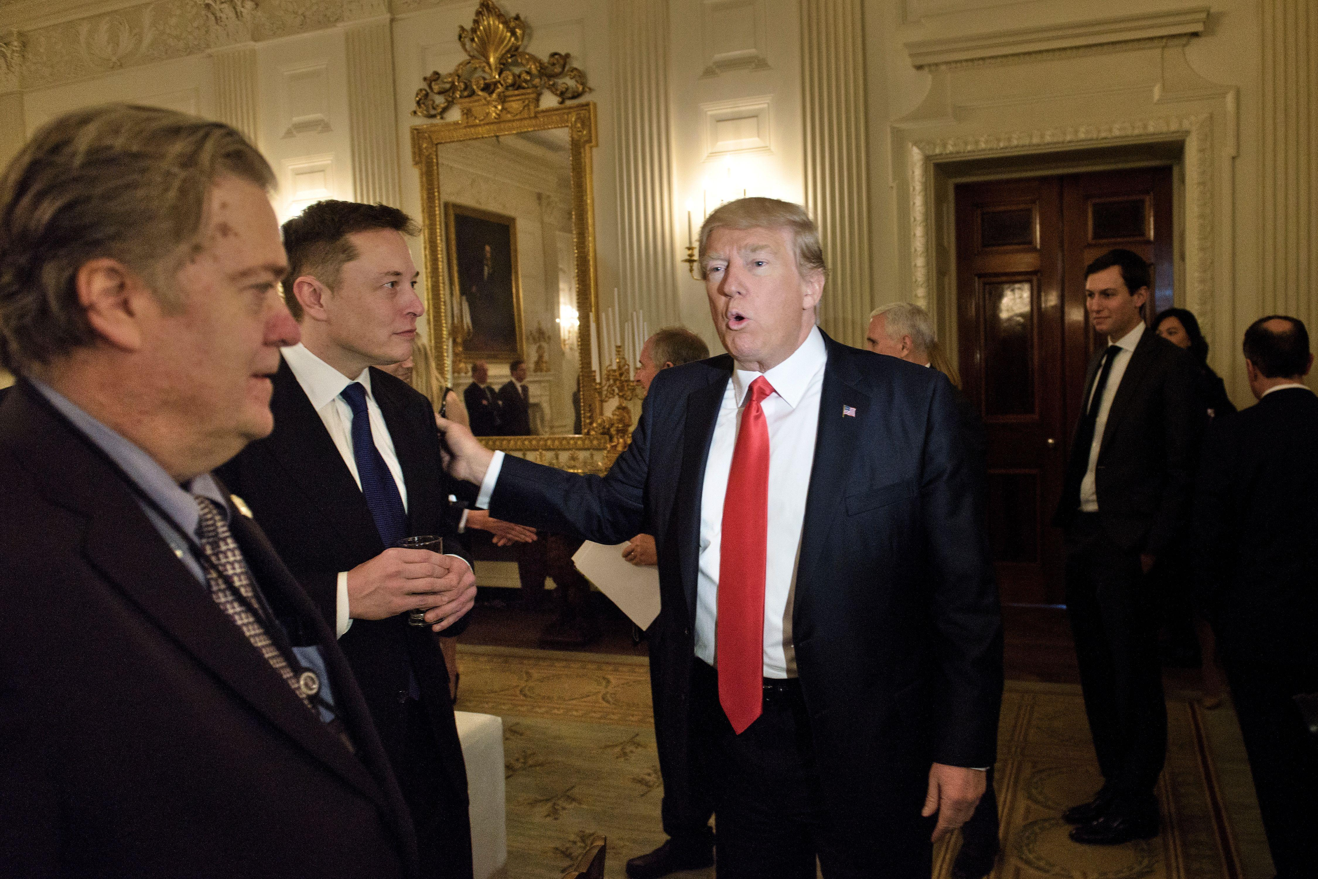 President Donald Trump meets with Tesla CEO Elon Musk at the White House.