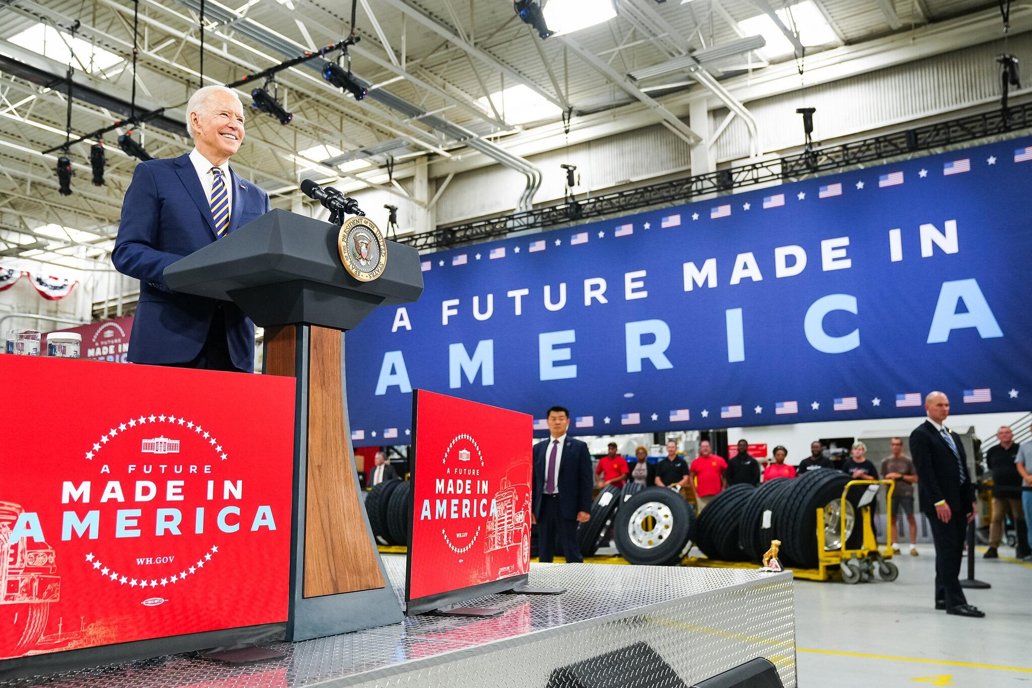 """President Biden with """"Made in America"""" signs"""
