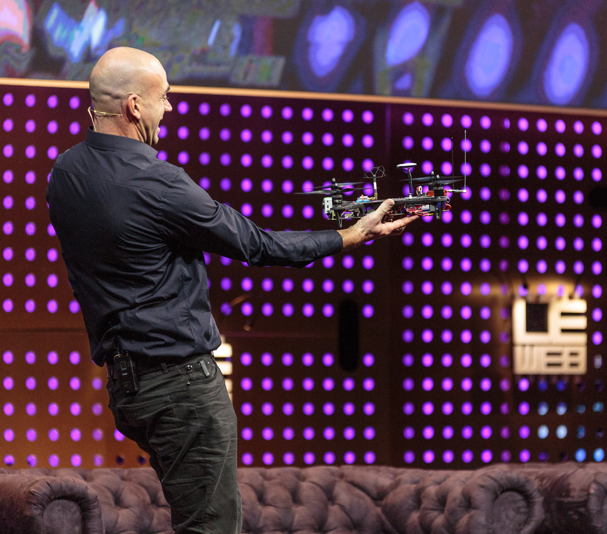 LeWeb conference founder Loic Le Meur flinches and laughs as a Team BlackSheep TBS Discovery quadcopter alights on his hand at LeWeb 2012.