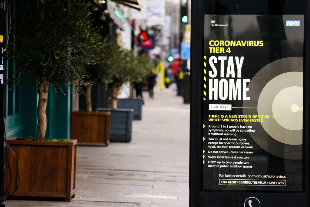 """A """"Stay Home"""" sign in London the day after Christmas."""