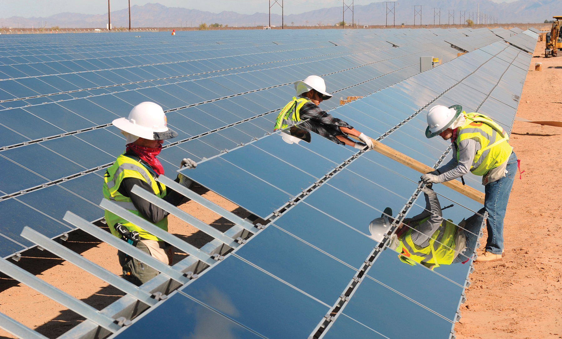 The Topaz Solar Plant in California will use rack-mounted First Solar panels, pictured here, spread out over 3,500 acres.