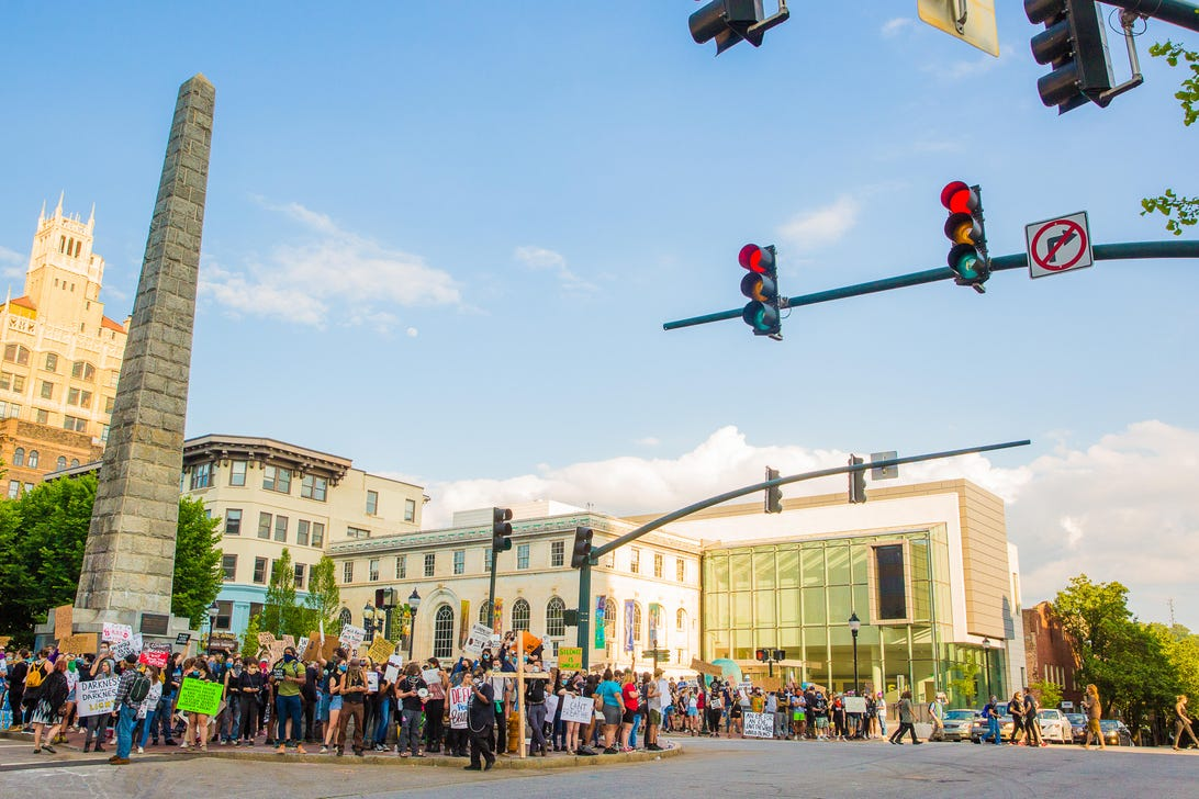 Protesters occupied the space around the Vance Memorial, staying on the sidewalk and peacefully demonstrating for all who drove through town. The protest here has been growing for days, and this would be the first night with an official curfew order, for 8 p.m., from the mayor.
