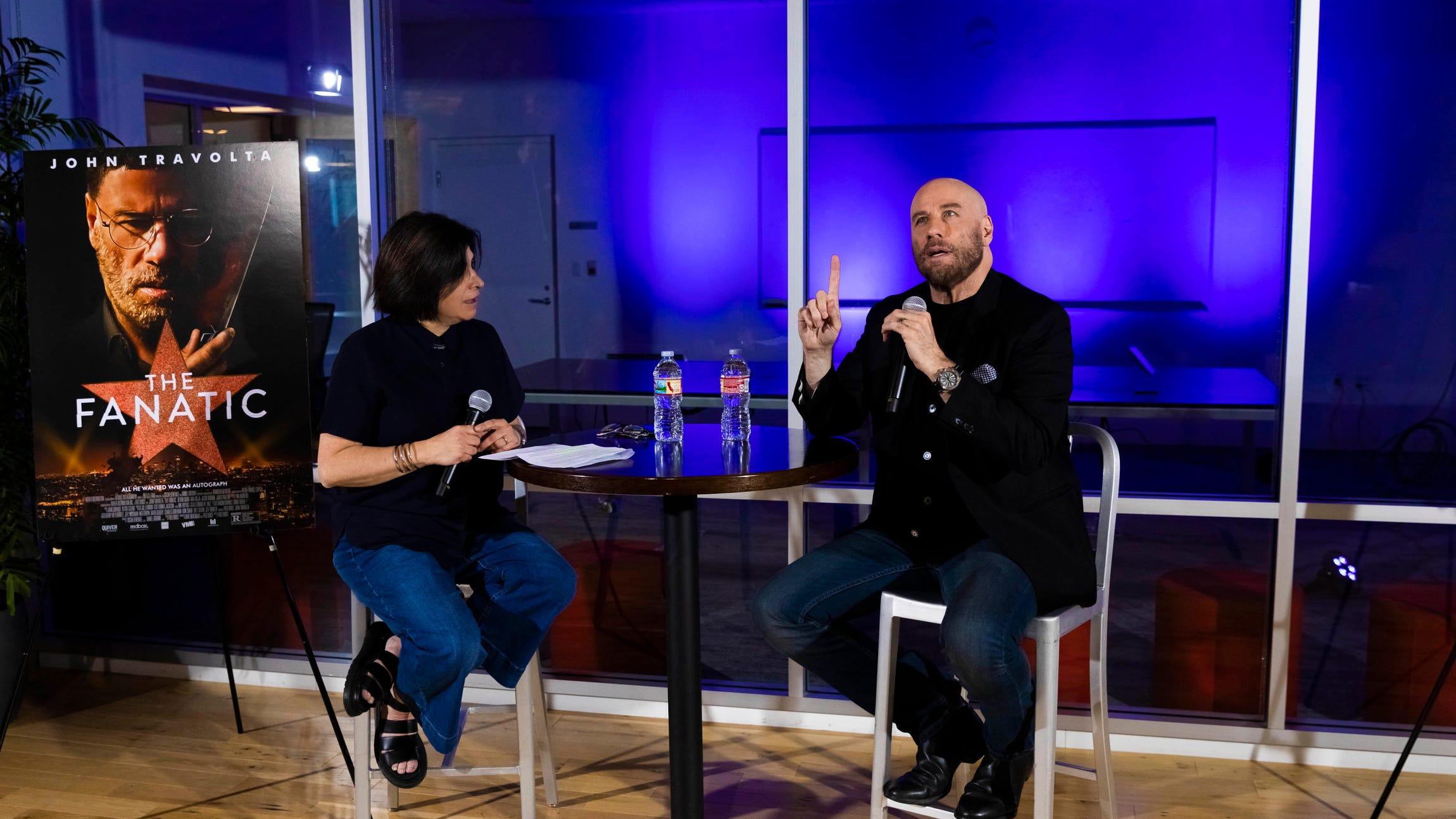 john-travolta-connie-guglielmo-interview-cnet-tw-0820.jpg