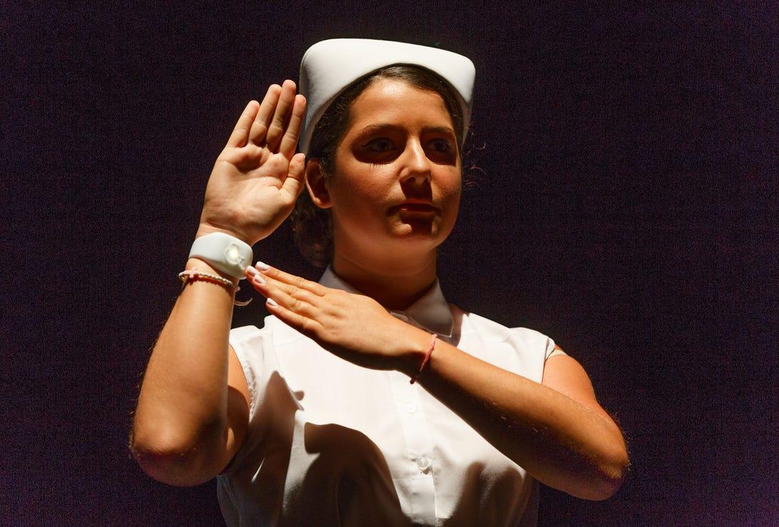 A nurse-attired actor shows off the emotion sensor.