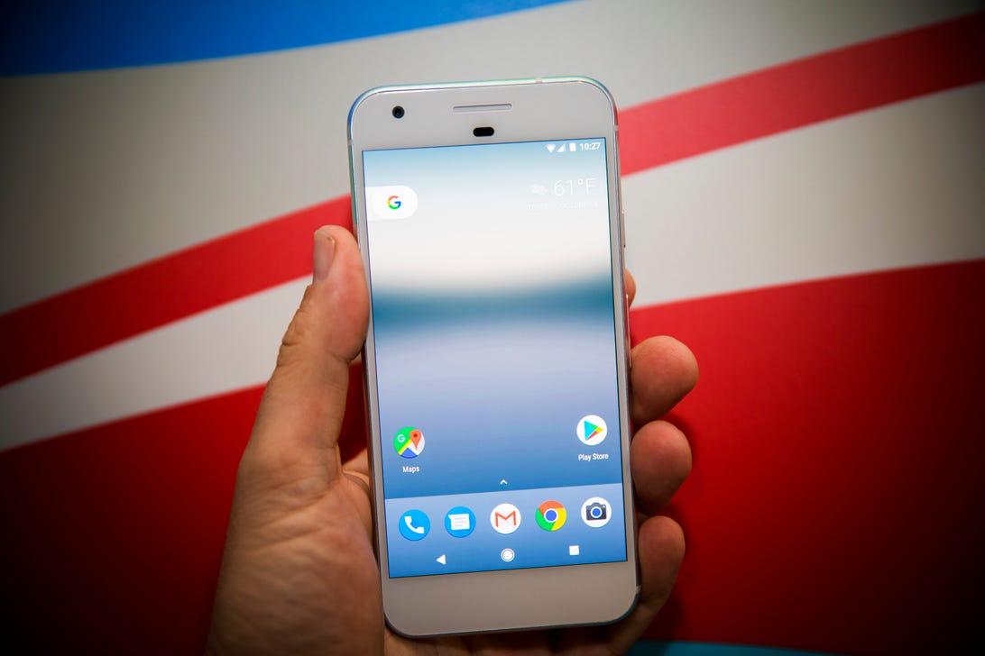 Google camera tech leader Tim Knight holds a Google Pixel phone.