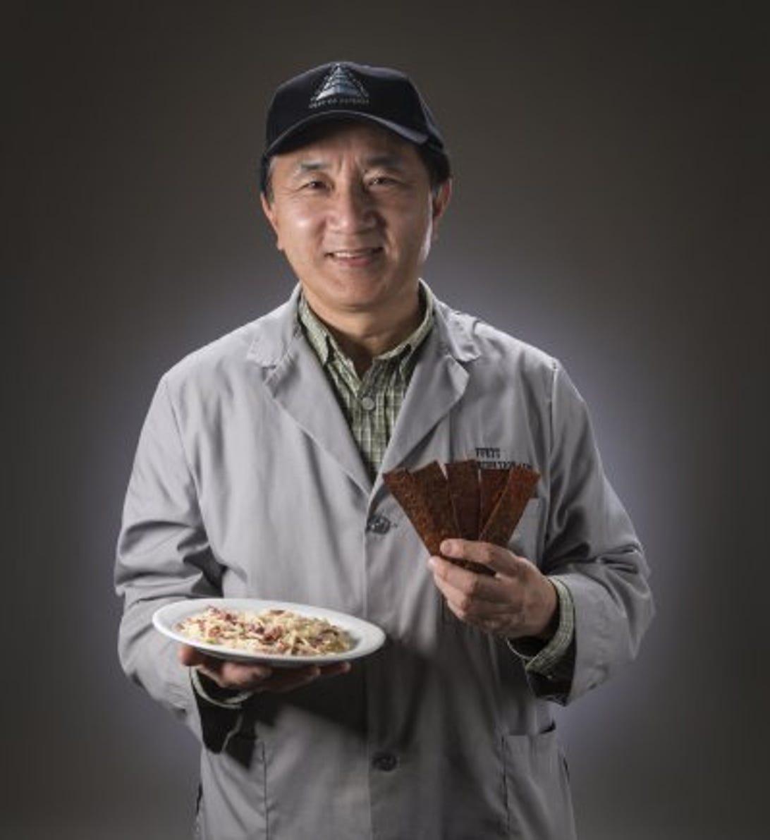 cnet-military-meat-dr-tom-yang-holds-jerky.jpg