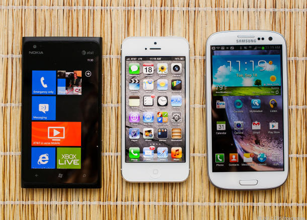 The iPhone, flanked by larger-screen competitors from Samsung and Nokia.