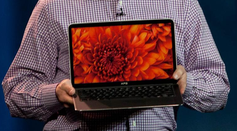 Intel's Clarke holds up the XPS 13, which is arriving later this year.