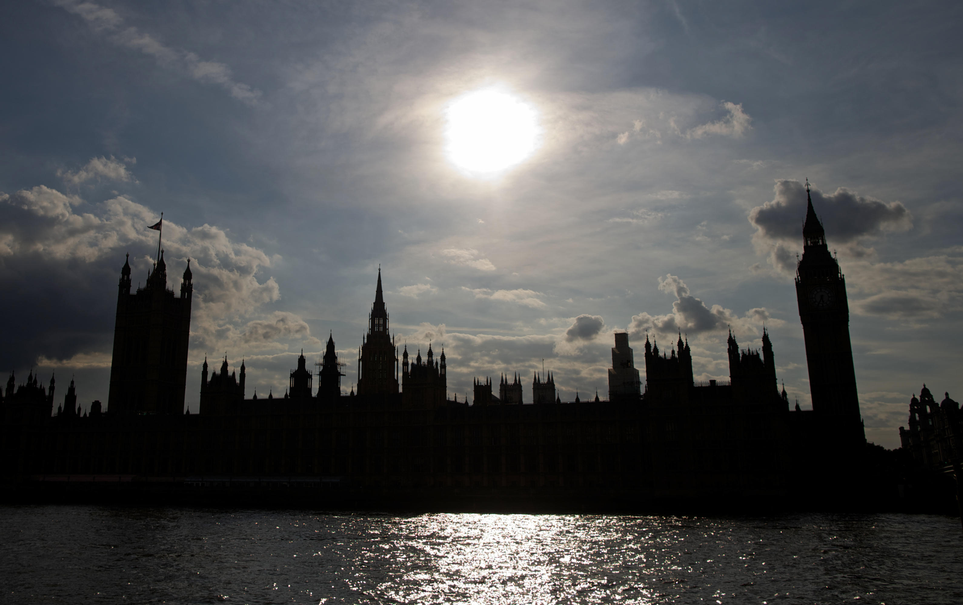 The Houses of Parliament silhouetted against a setting sun