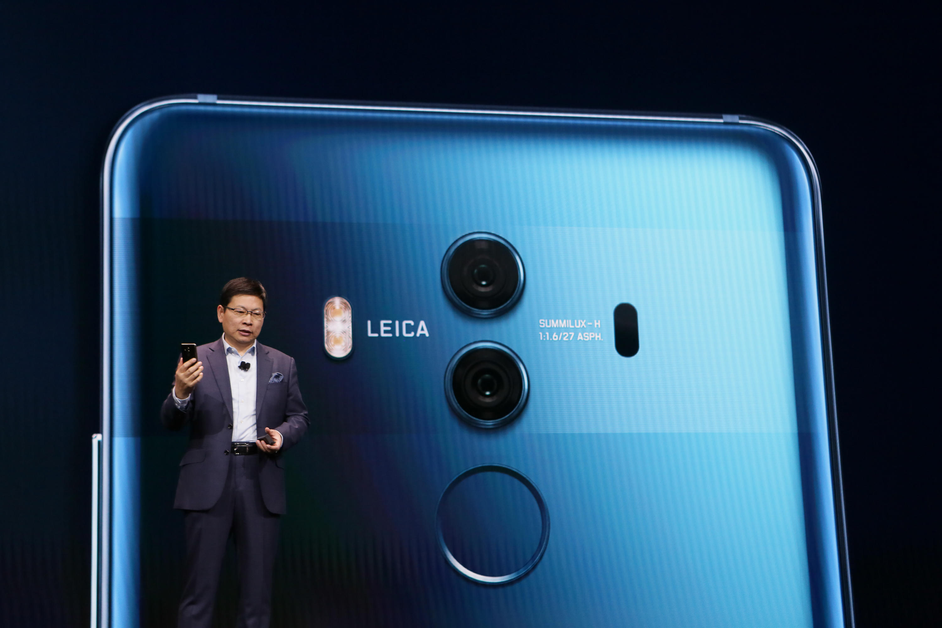 Richard Yu, CEO of Huawei's consumer business group, touts the Mate 10 Pro Porsche Edition at CES.