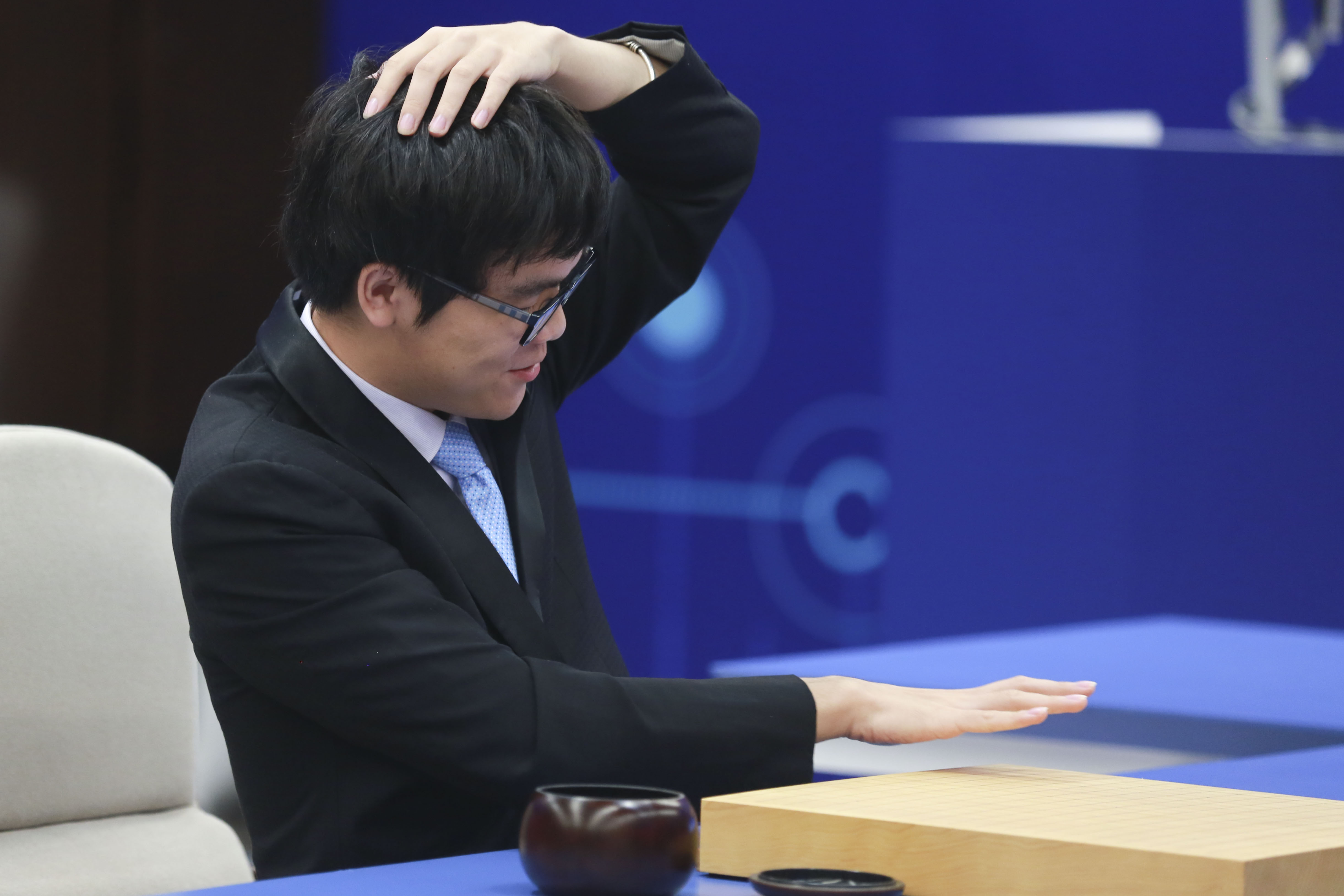 Ke Jie reacts during go game against Google's AlphaGo.