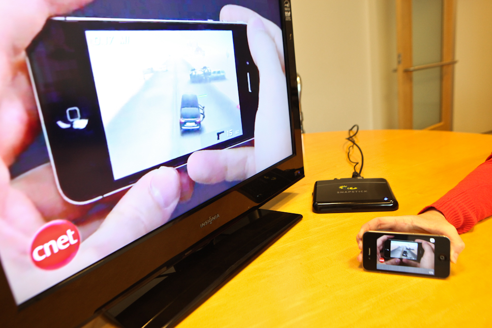 Snapstick can use the iPhone to choose an Internet video that plays on this TV monitor.