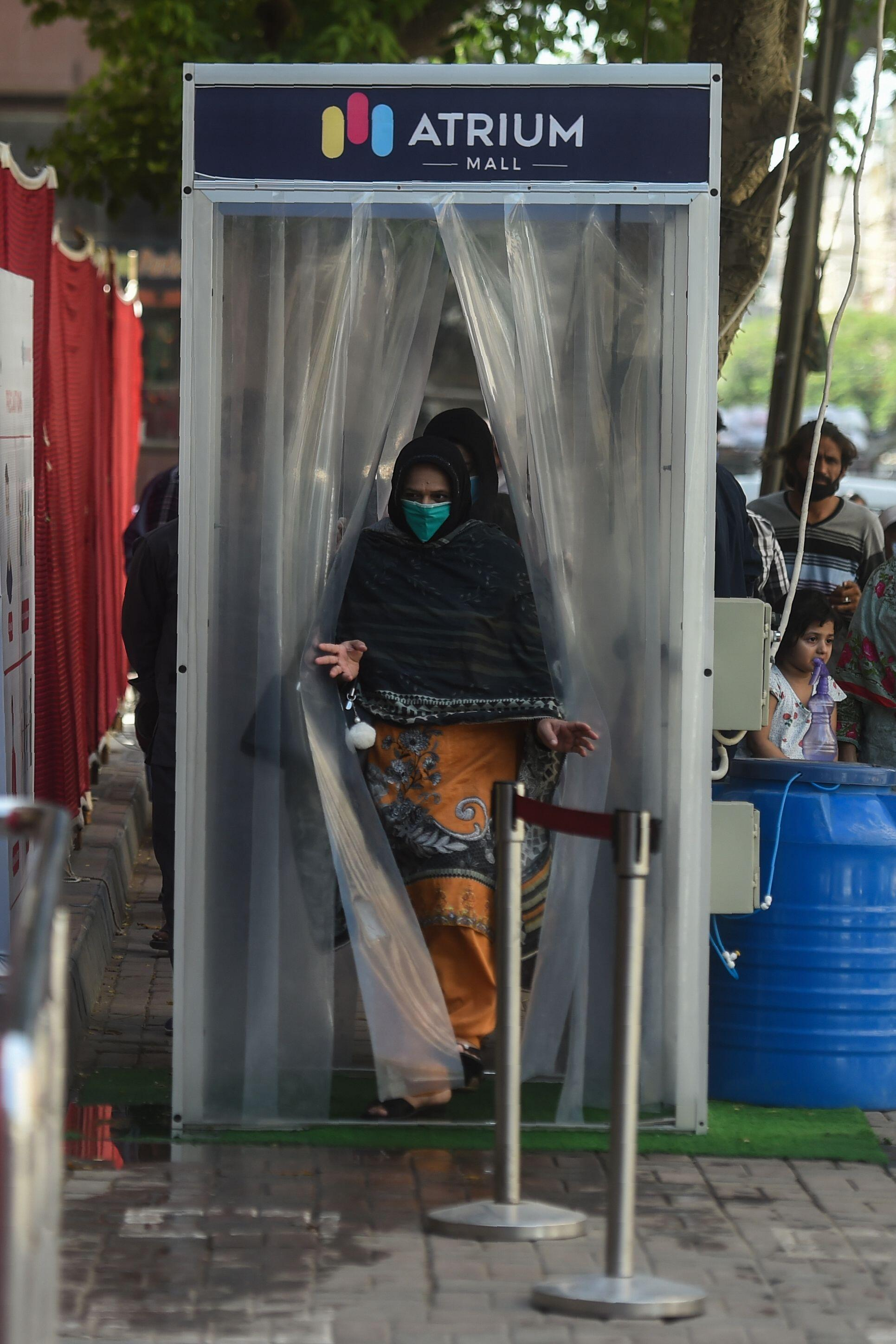 Pakistan: Getting disinfected before shopping