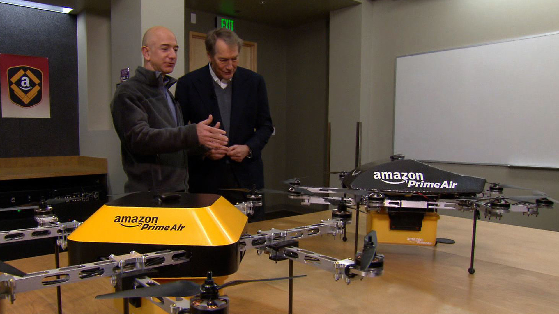 Amazon CEO Jeff Bezos shows Charlie Rose prototypes of the delivery drones.