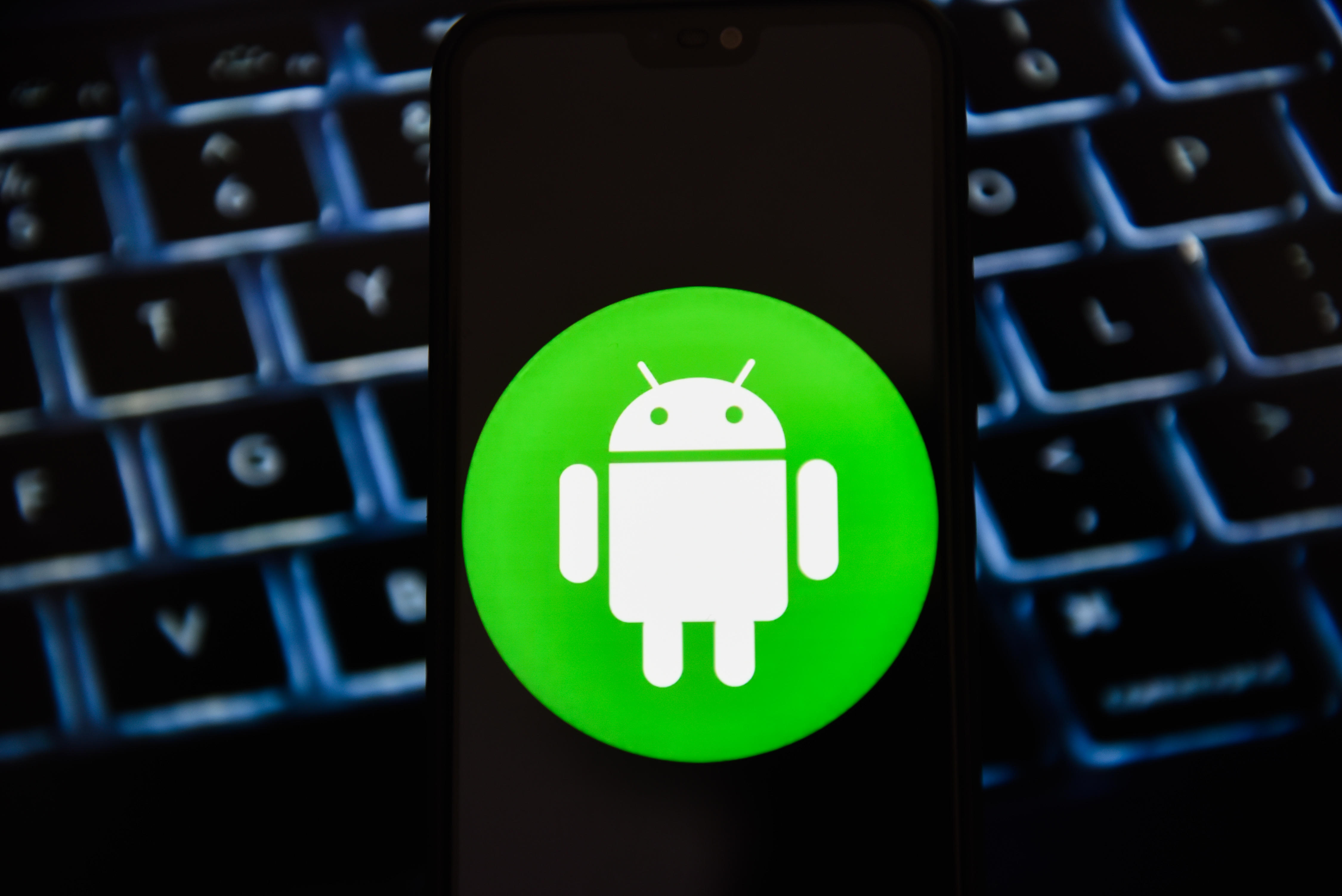 In this photo illustration a Android logo seen displayed on