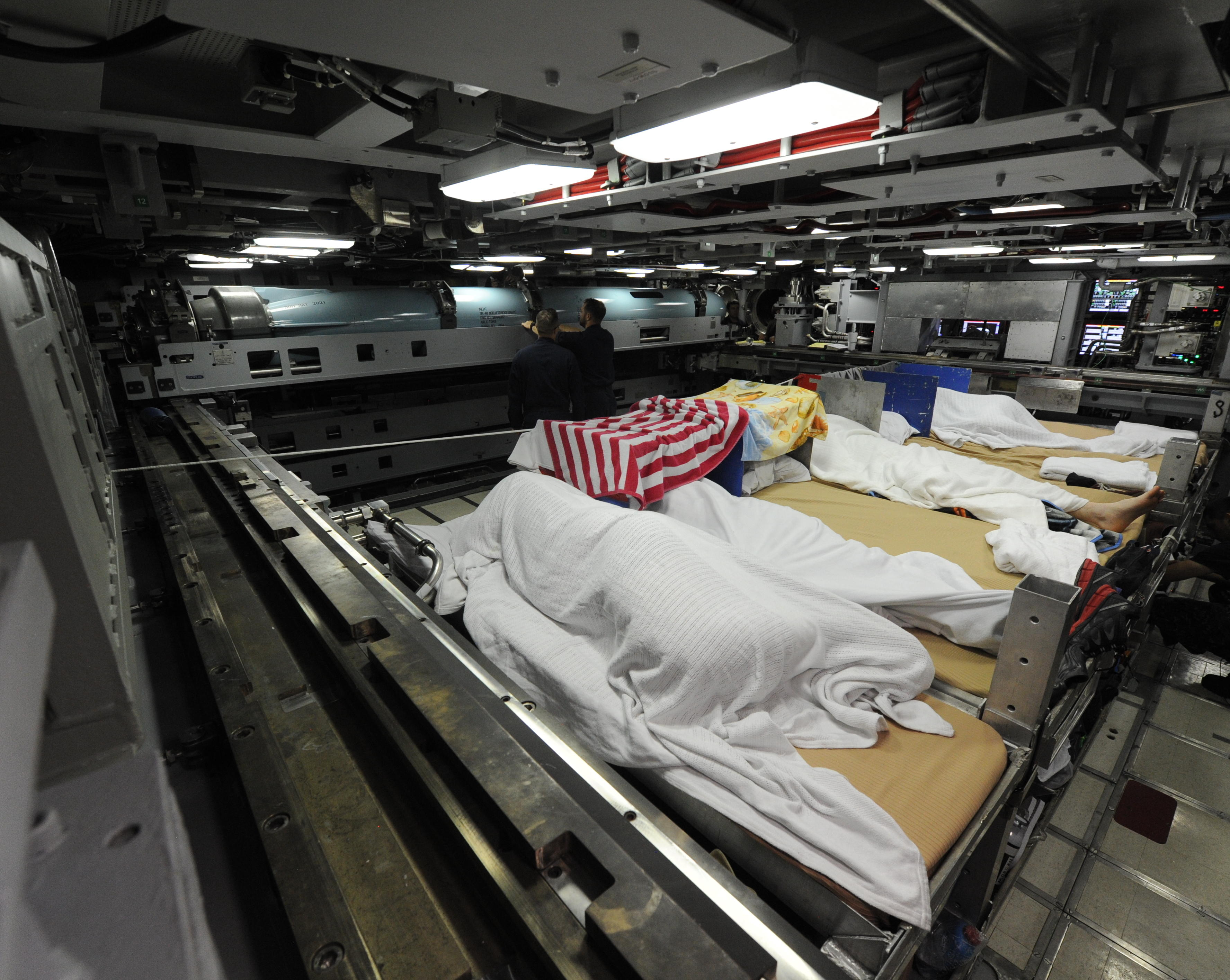 Sleeping in the torpedo room of the USS Indiana