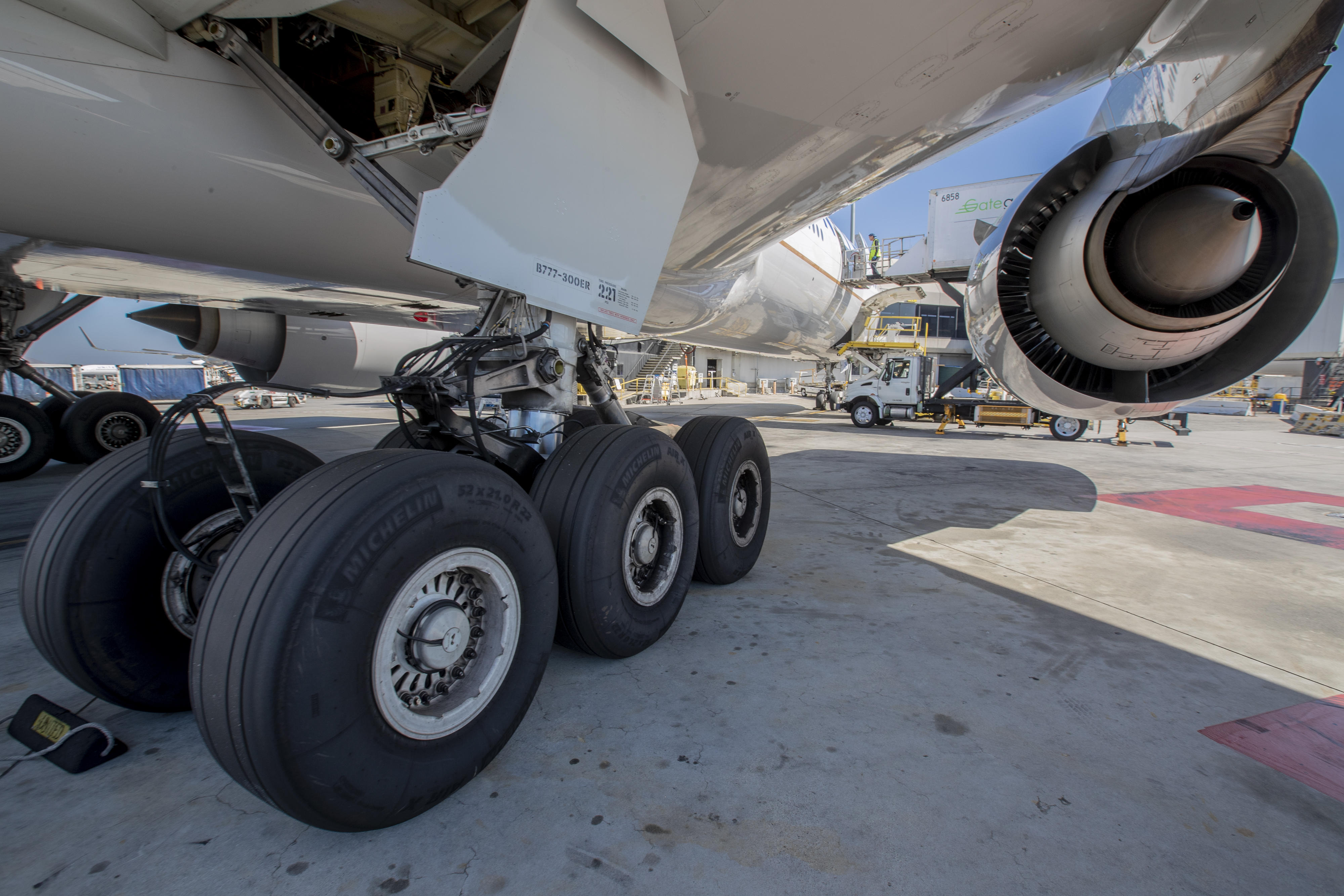 Rubber wedges called chocks are placed around an airplane's landing gear to keep the plane from moving.